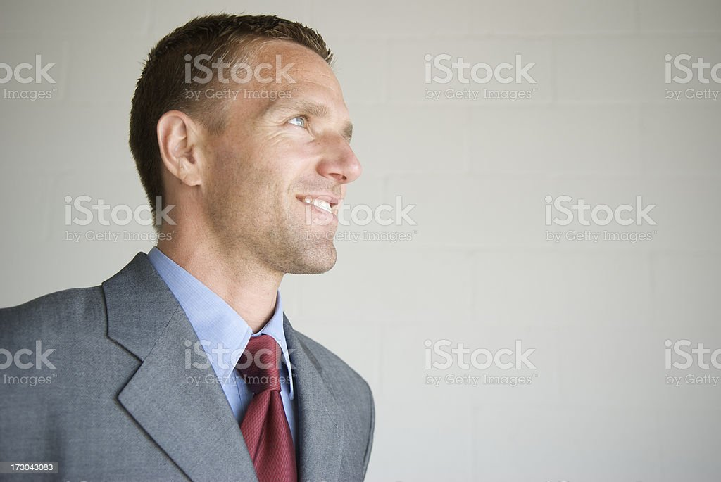 Confident Businessman Smiles in Profile royalty-free stock photo