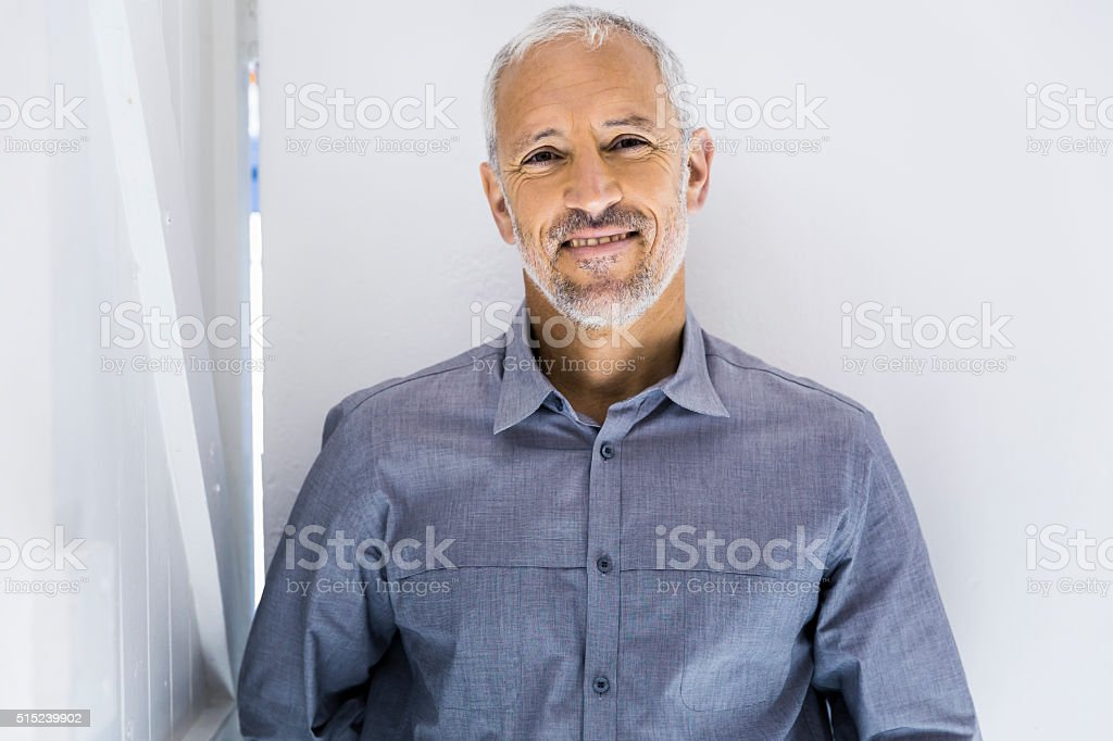 Confident businessman smiling in office stock photo
