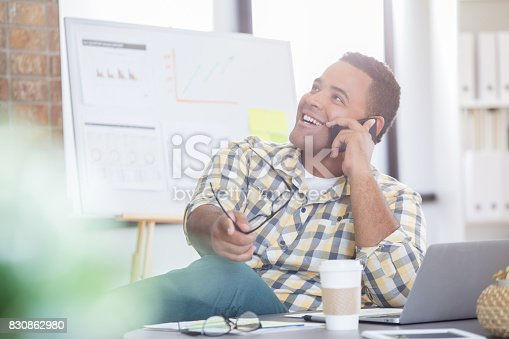 913346608 istock photo Confident businessman talks on phone with client 830862980