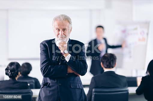 905746192 istock photo Confident Businessman  Thinking  in conference room.Successful Cooperation Organization People Concept 1033916046