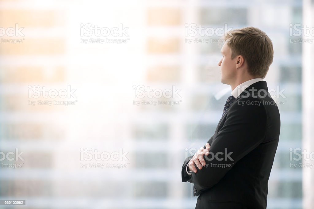 Confident businessman waiting for the meeting stock photo