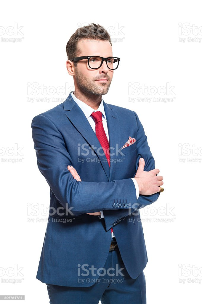 Confident businessman wearing elegant suit and glasses Portrait of elegant CEO wearing elegant suit and nerd glasses, looking away with vision. Studio shot, one person, white background. Adult Stock Photo