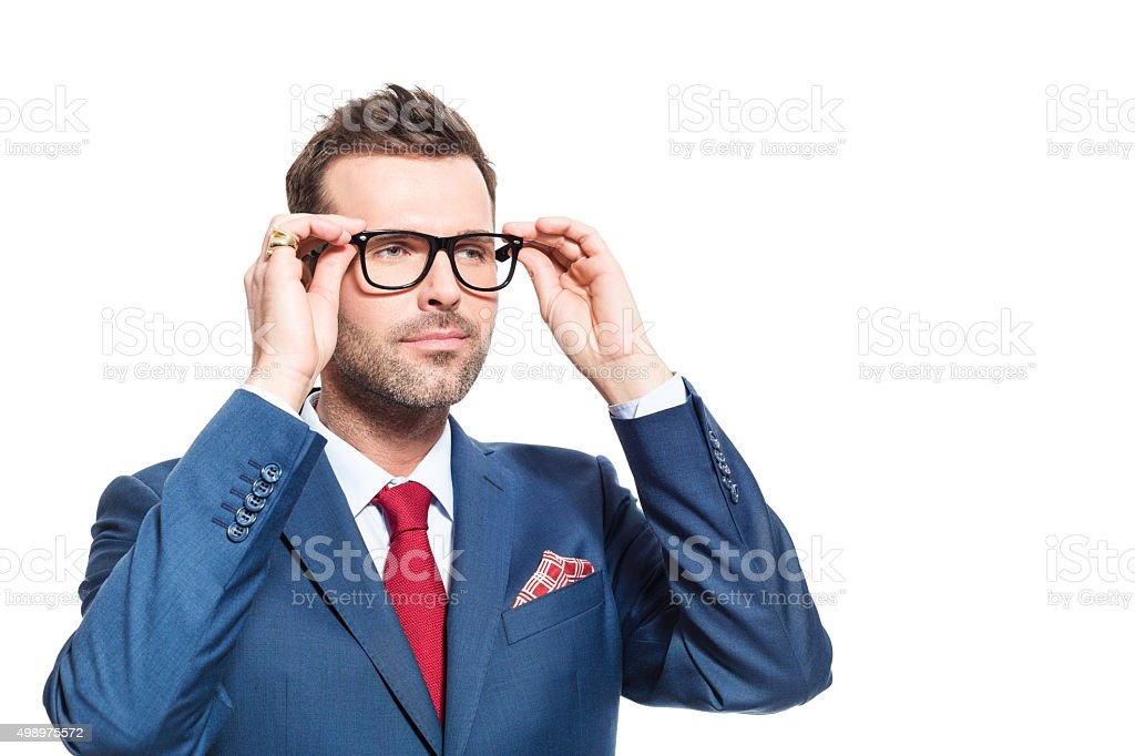 Confident businessman wearing suit and nerd glasses Portrait of elegant businessman wearing suit and nerd glasses. Studio shot, one person, isolated on white. 2015 Stock Photo