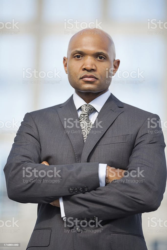 Confident Businessman With Arms Crossed royalty-free stock photo