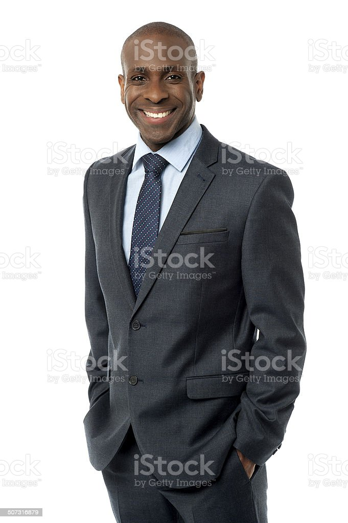 Confident businessman with hands in pockets royalty-free stock photo