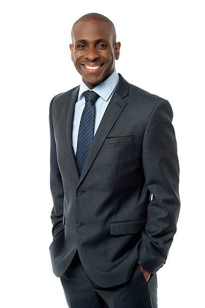 Confident businessman with hands in pockets stock photo