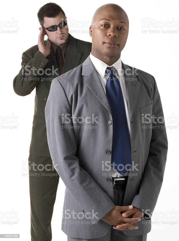 Confident businessman with security man in background royalty-free stock photo