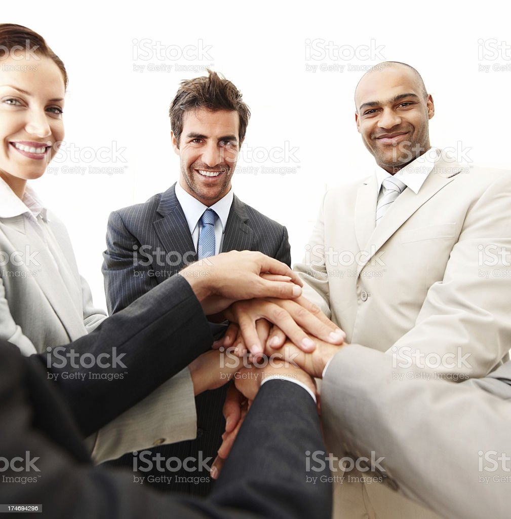 Confident businesspeople joining their hands royalty-free stock photo