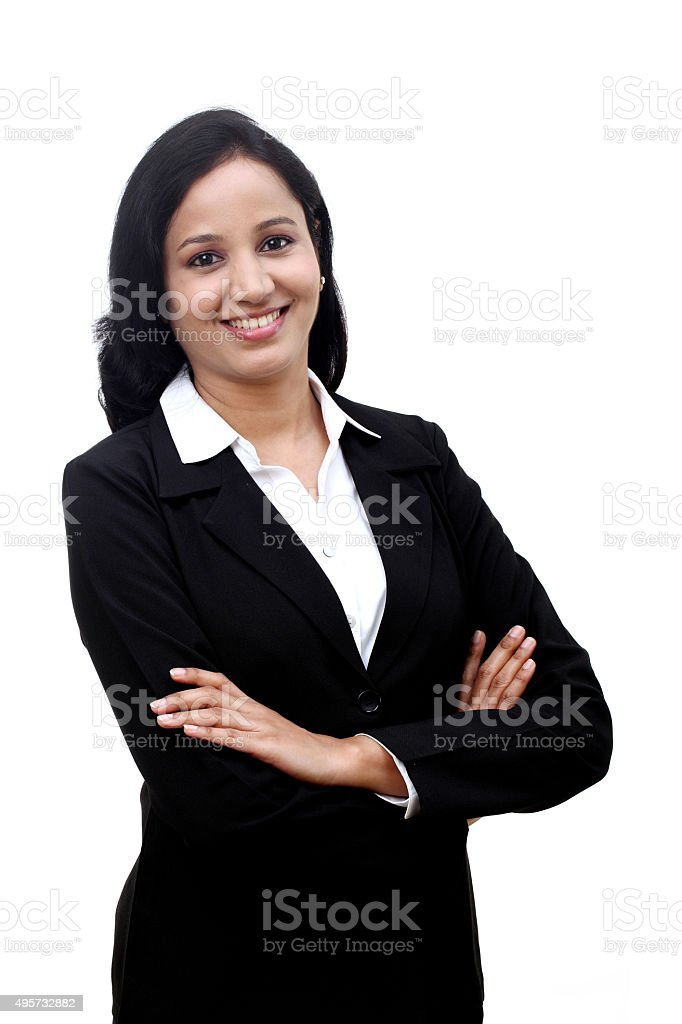 Confident Businesswoman against white background stock photo