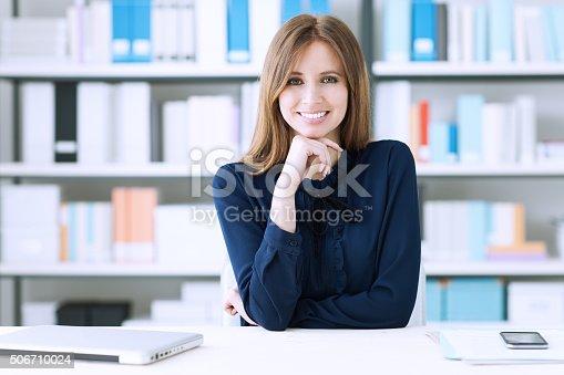 istock Confident businesswoman at desk 506710024