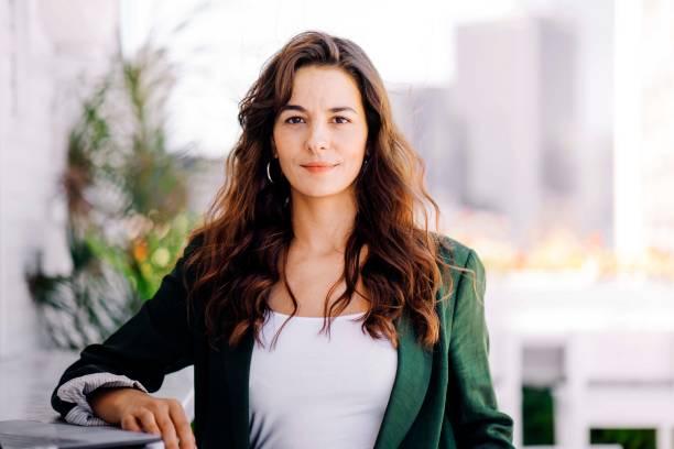 Confident businesswoman at hotel stock photo