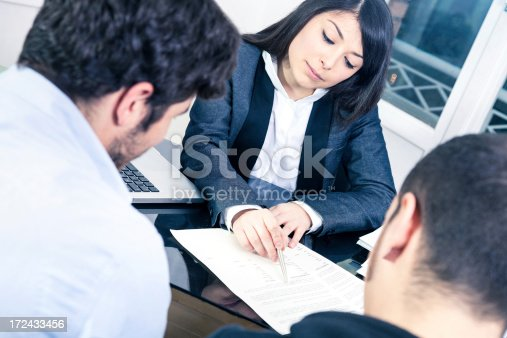 istock Confident businesswoman explaining to customers 172433456