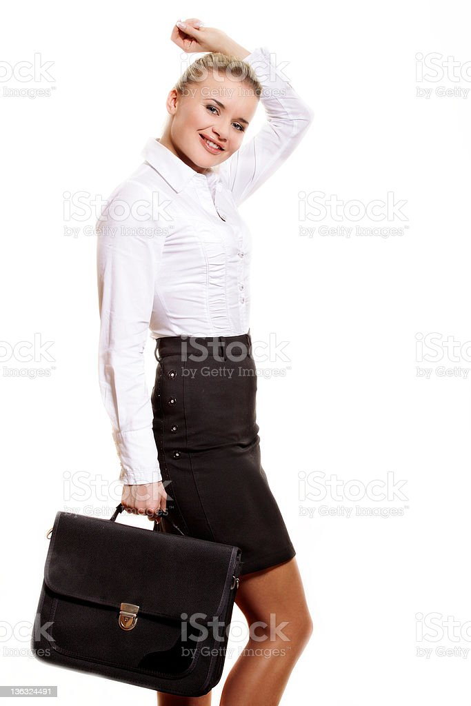 Confident businesswoman holding a briefcase. stock photo