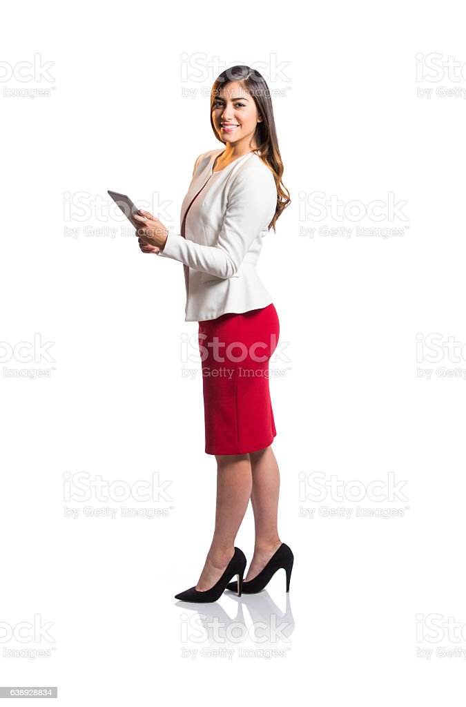 Confident businesswoman holding tablet and smiling at camera - foto de stock
