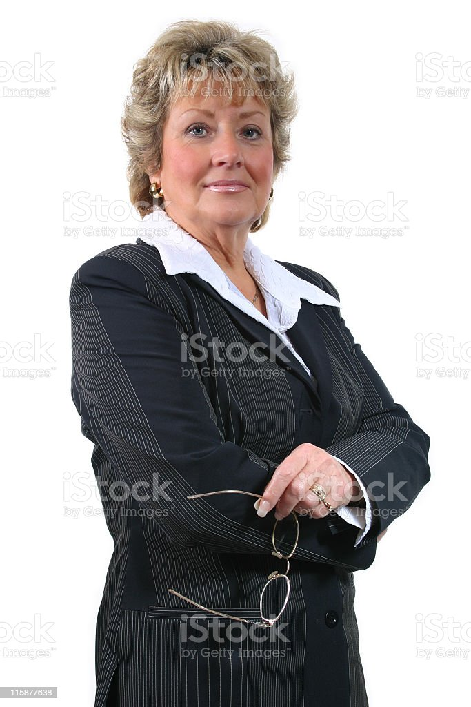 A confident businesswoman in black with glasses stock photo