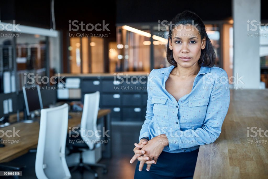 Confident businesswoman in textile factory stock photo