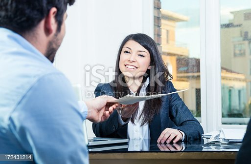 istock Confident businesswoman receiving contracts 172431214