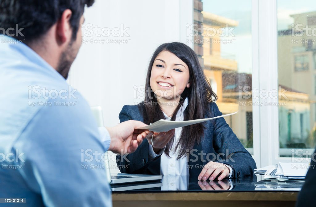 Confident businesswoman receiving contracts stock photo
