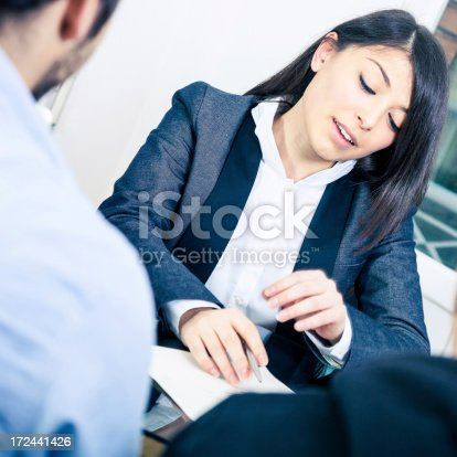 istock Confident businesswoman showing contracts 172441426