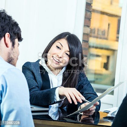 155279487 istock photo Confident businesswoman showing contracts 172482228