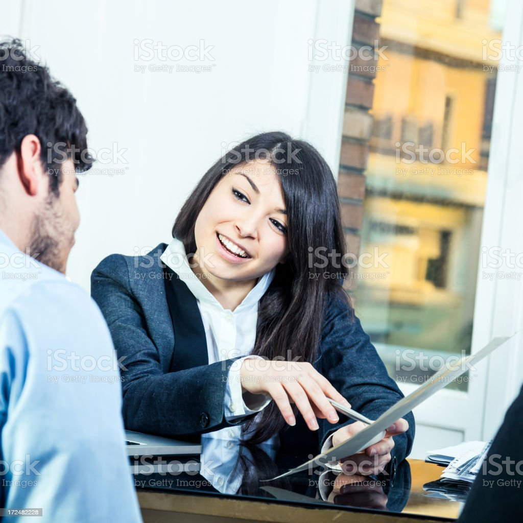 Confident businesswoman showing contracts stock photo
