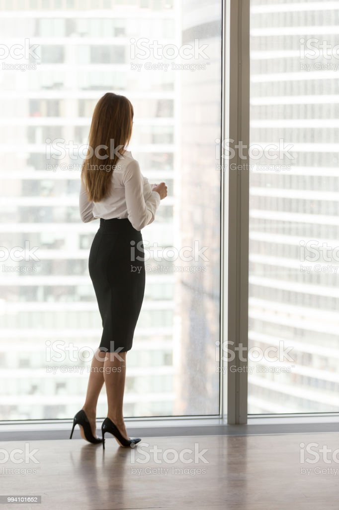Confident businesswoman boss standing at modern office or hotel...