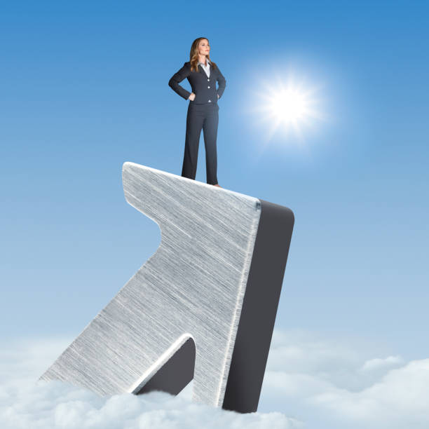 Confident Businesswoman Stands On Large Arrow Above The Clouds stock photo