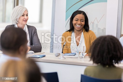 640177838 istock photo Confident businesswoman talks during panel discussion 1136648317