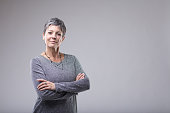 istock Confident businesswoman with folded arms 1029559428