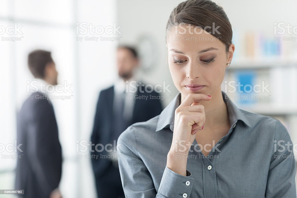 Confident businesswoman with hand on chin royalty-free stock photo