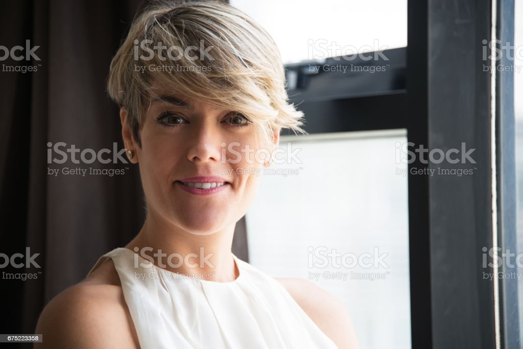 Confident businesswoman with modern hairstyle royalty-free stock photo