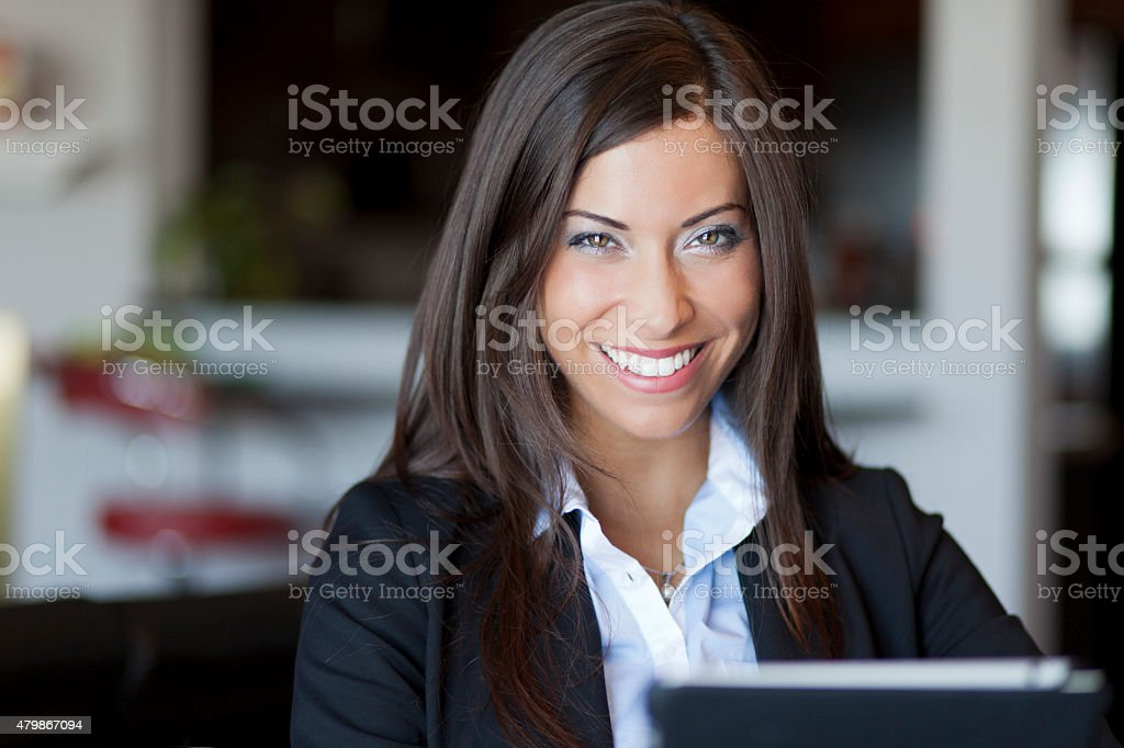 Confident Businesswoman Working At Home stock photo