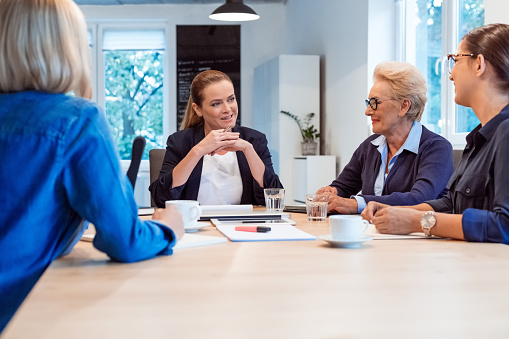 Confident Businesswomen Planning Strategy At Table Stock Photo - Download Image Now