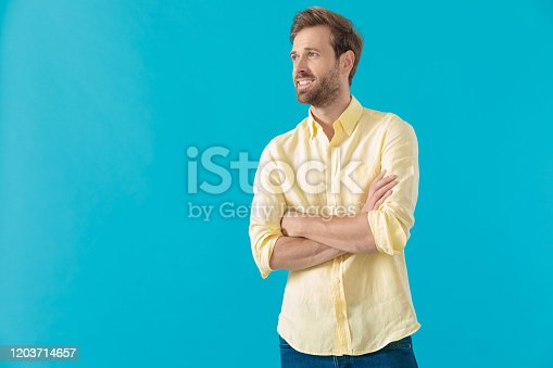 1165538246 istock photo Confident casual man looking away with his arms folded 1203714657