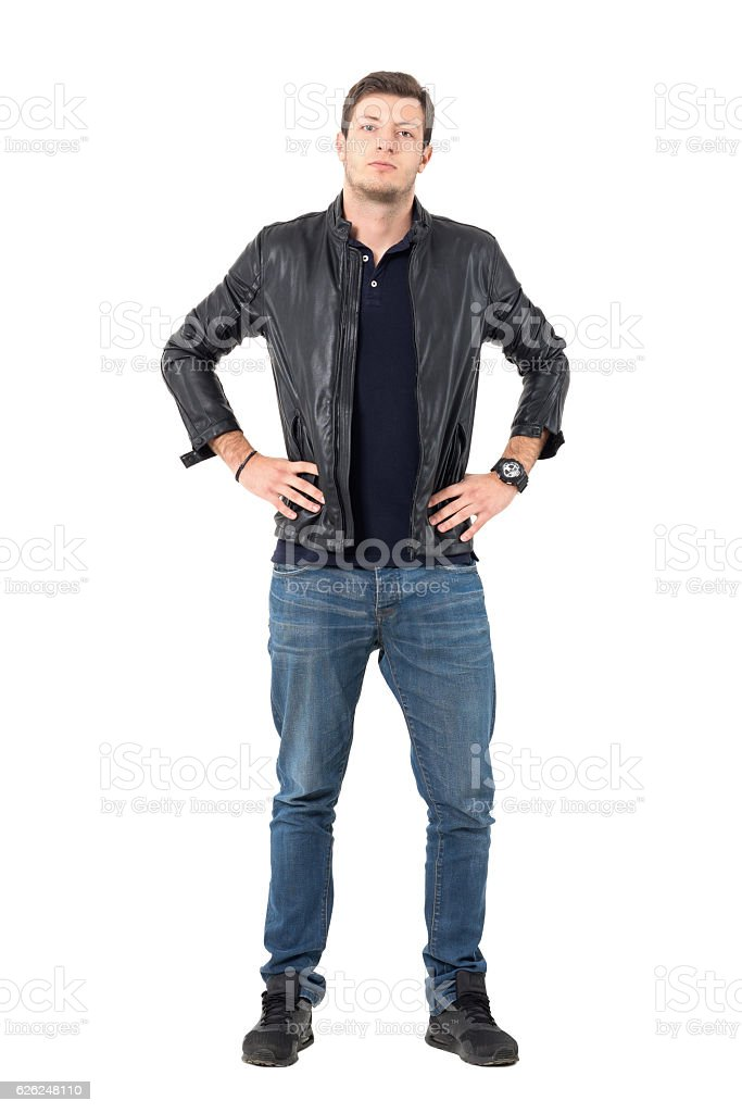 Confident casual man wearing jacket with hands on hips stock photo