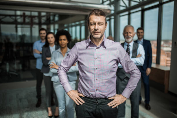 Confident CEO in front of his team! stock photo