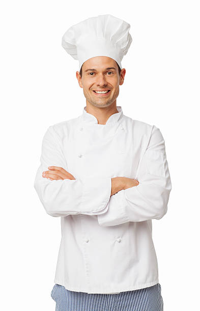 Confident Chef In Uniform Standing Arms Crossed Portrait of confident chef in uniform standing arms crossed over white background. Vertical shot. chef's whites stock pictures, royalty-free photos & images