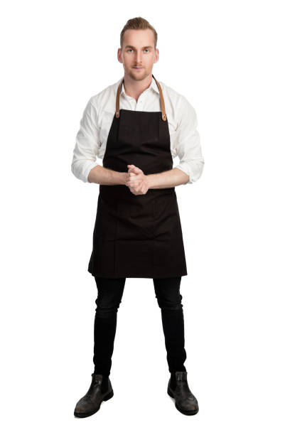 confident chef in white shirt and black apron - apron stock pictures, royalty-free photos & images
