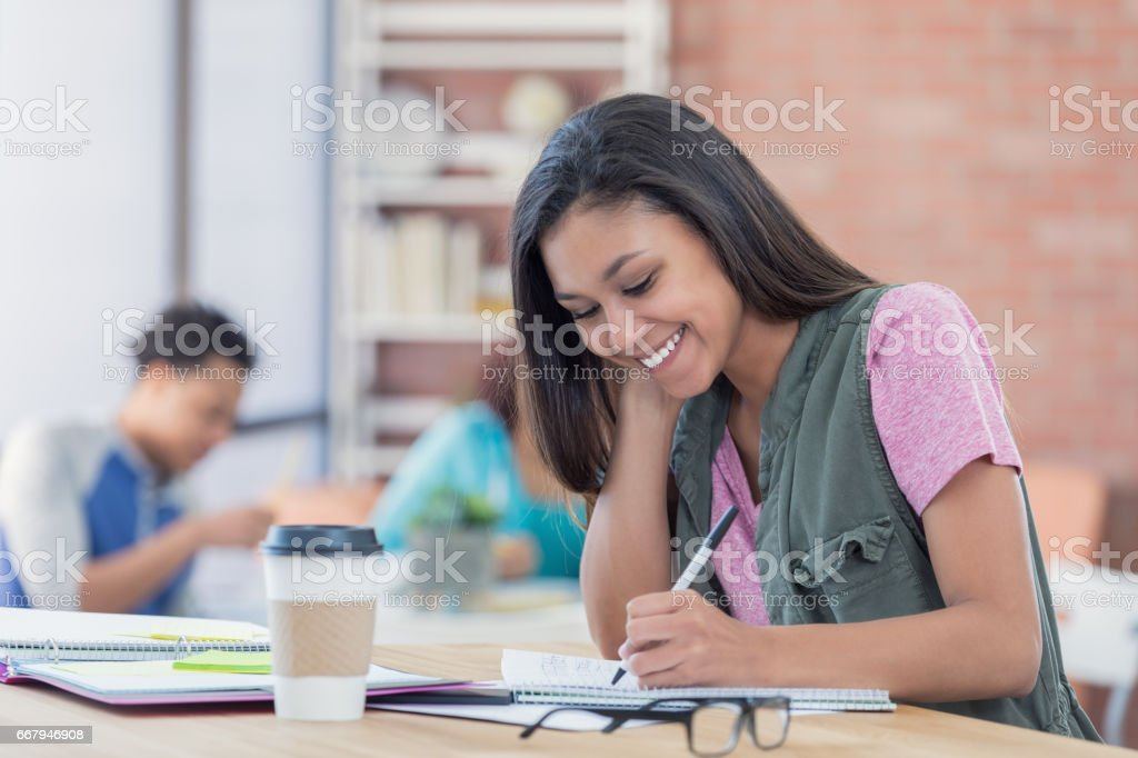 Confident college girl in the student lounge stock photo