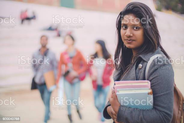 Confident college student looking at camera with smile picture id920040768?b=1&k=6&m=920040768&s=612x612&h=67fnp0obpznw3r hshkrk0s2jfxqogdaxhmsvmfcyzo=