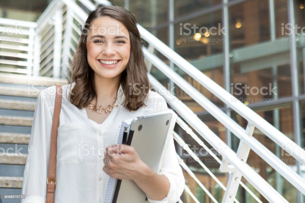 Confident college student on her way to class stock photo