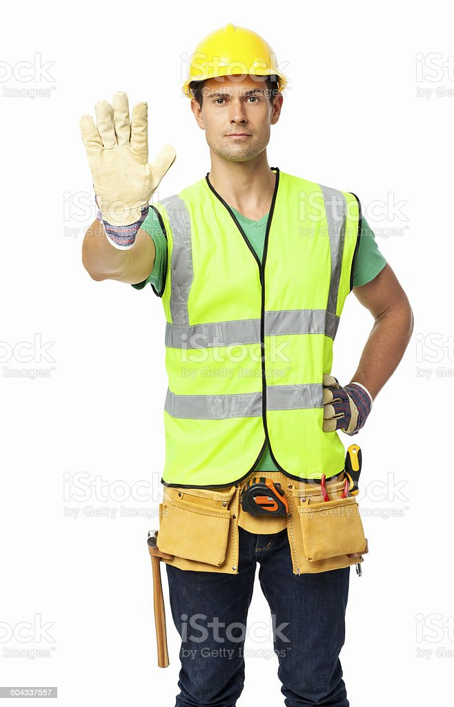 Confident Construction Worker Gesturing Stop Sign royalty-free stock photo