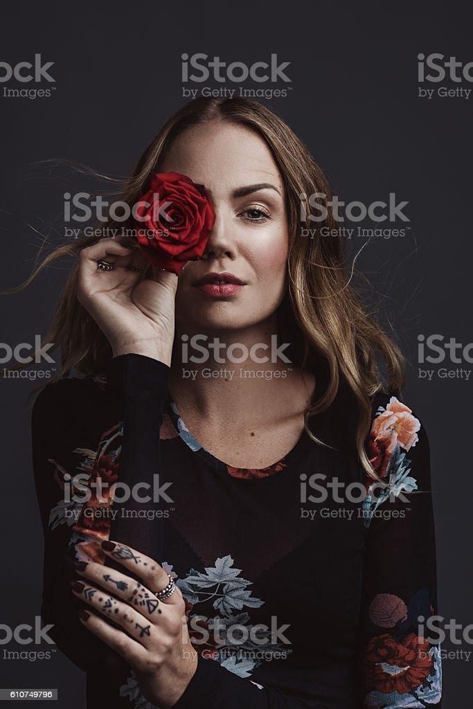 Confident cool real woman studio portrait stock photo