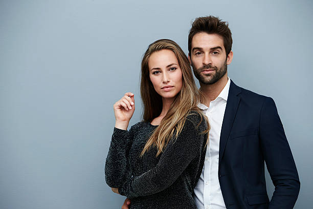 Confident couple in smart clothing, portrait stock photo
