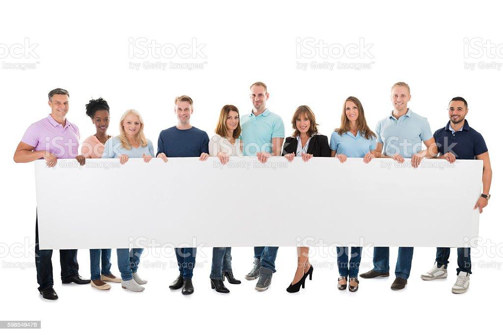 Confident Creative Business Team Holding Blank Billboard - foto de acervo