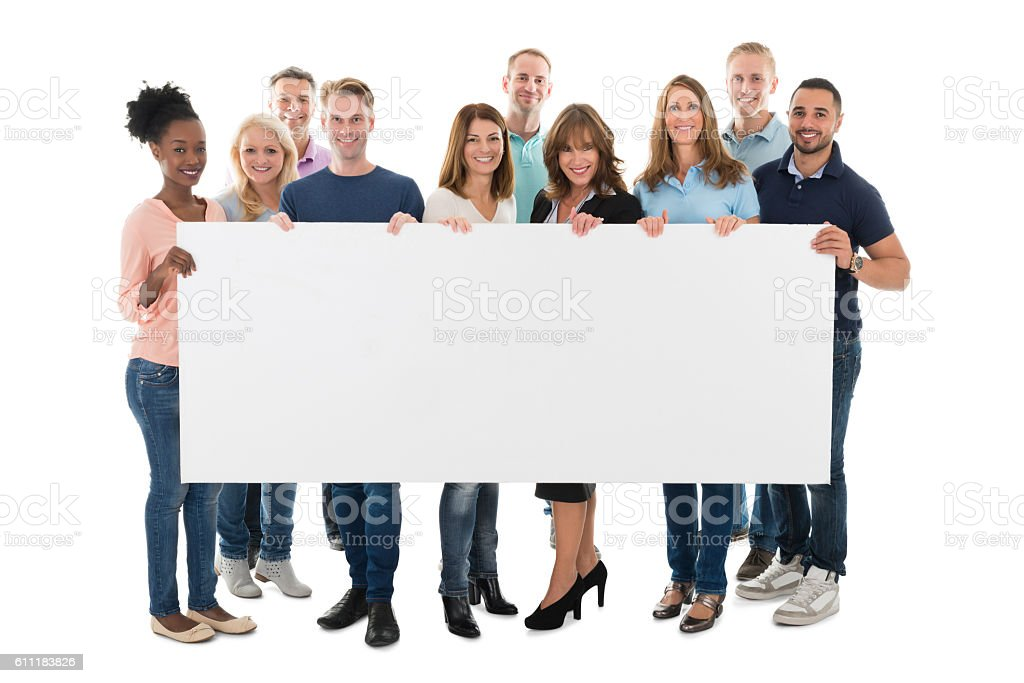 Confident Creative Business Team Holding Blank Billboard stock photo