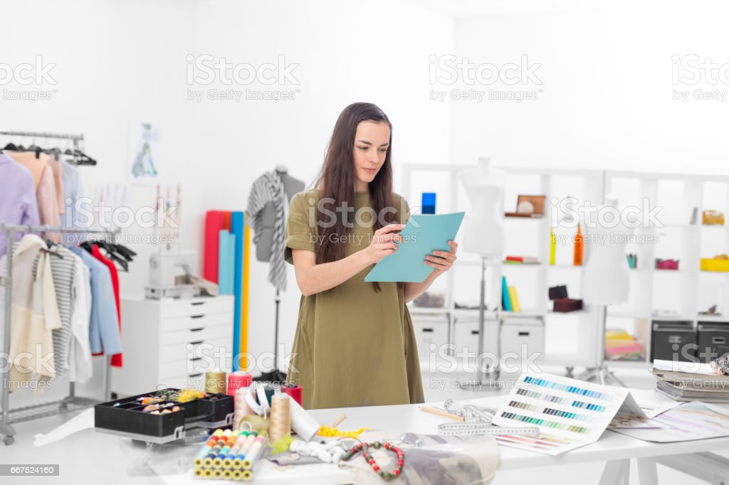confident designer checking the ordering foto stock royalty-free