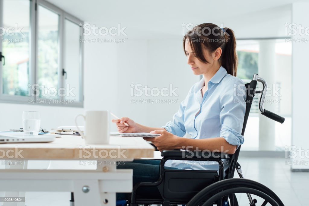 Confident disabled businesswoman at work stock photo