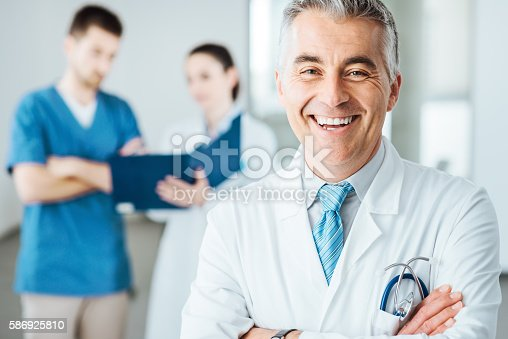 istock Confident doctor at hospital posing 586925810