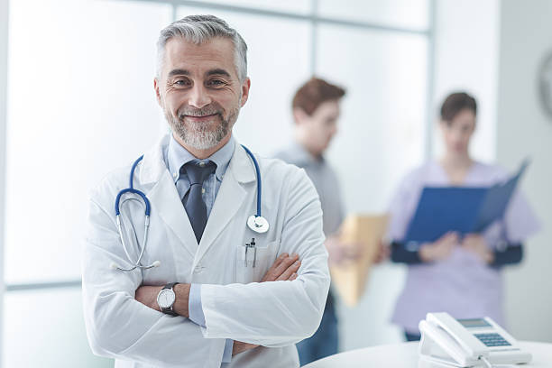 Confident doctor at the reception desk stock photo